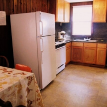 Kitchen with a gas stove, coffee maker, and cooking utensils.